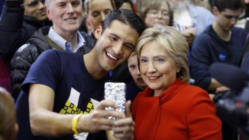Democratic presidential candidate Hillary Clinton poses for a selfie with a supporter after speaking at Valley Southwoods Freshman High School in West Des Moines, Iowa, Sunday, Jan. 24, 2016. (AP Photo/Patrick Semansky)