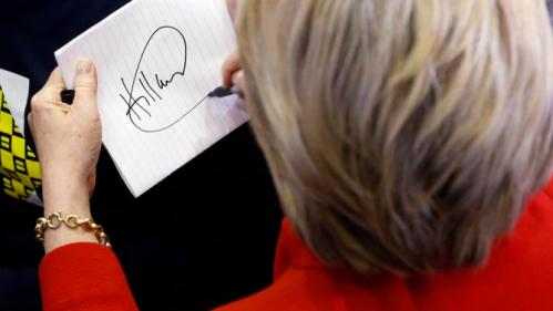 Democratic presidential candidate Hillary Clinton signs an autograph after speaking at Valley Southwoods Freshman High School in West Des Moines, Iowa, Sunday, Jan. 24, 2016. (AP Photo/Patrick Semansky)