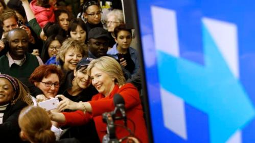 Democratic presidential candidate Hillary Clinton takes a selfie with a supporter after speaking at Valley Southwoods Freshman High School in West Des Moines, Iowa, Sunday, Jan. 24, 2016. (AP Photo/Patrick Semansky)