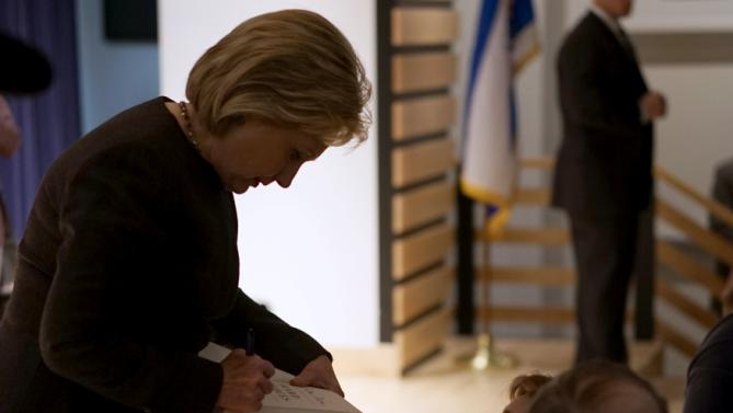 Democratic presidential candidate Hillary Clinton signs a book for a supporter at the Jewish Federation of Greater Des Moines while campaigning in Des Moines, Iowa January 25, 2016.   REUTERS/Rick Wilking