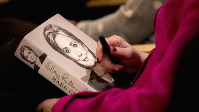 "An audience member holds a copy of ""Hard Choices"" in hopes to get it autographed by Democratic presidential candidate Hillary Clinton during Clinton's campaign event at the Jewish Federation of Greater Des Moines, Monday, Jan. 25, 2016, in Des Moines, Iowa. (AP Photo/Mary Altaffer)"