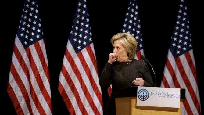 Democratic presidential candidate Hillary Clinton struggles to contain a coughing fit as she speaks at the Jewish Federation of Greater Des Moines while campaigning in Des Moines, Iowa January 25, 2016.   REUTERS/Rick Wilking