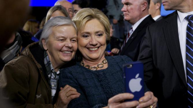 U.S. Democratic presidential candidate Hillary Clinton takes a photo with a supporter at a campaign event in Decorah, Iowa, January 26, 2016. REUTERS/Rick Wilking