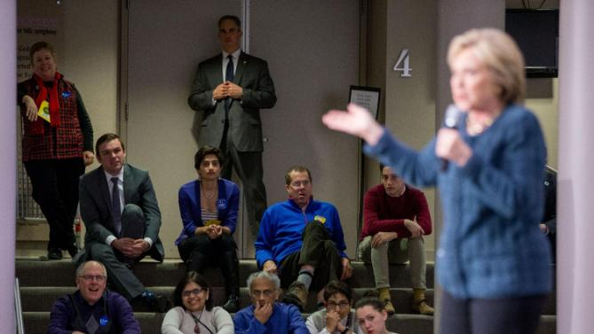 Members of the audience listen as Democratic presidential candidate Hillary Clinton speaks at a rally at Gallagher Bluedorn Performing Arts Center University of Northern Iowa in Cedar Falls, Iowa, Tuesday, Jan. 26, 2016. (AP Photo/Andrew Harnik)