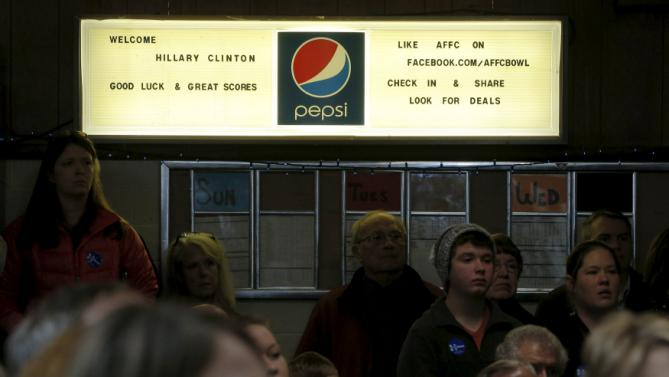 A sign welcomes U.S. Democratic presidential candidate Hillary Clinton to a campaign stop at the Family Fun Center in Adel, Iowa January 27, 2016.  REUTERS/Brian Snyder