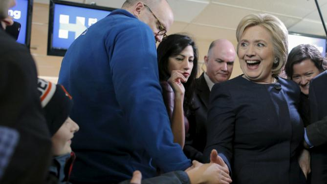 U.S. Democratic presidential candidate Hillary Clinton greets people at a campaign stop at the Family Fun Center in Adel, Iowa January 27, 2016. REUTERS/Brian Snyder