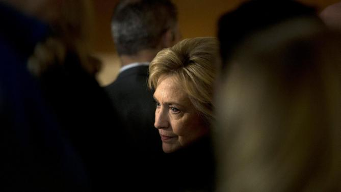 Democratic presidential candidate Hillary Clinton listens to a supporter at a campaign event at Adel Family Fun Center Wednesday, Jan. 27, 2016, in Adel, Iowa. (AP Photo/Jae C. Hong)