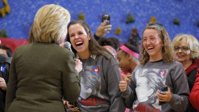 U.S. Democratic presidential candidate Hillary Clinton greets Grinnell College students Mollie Jo Blahunka (C) and Hannah Lundberg (R) during a campaign stop at the Berg Middle School in Newton, Iowa January 28, 2016. REUTERS/Brian Snyder