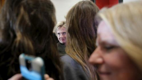 U.S. Democratic presidential candidate Hillary Clinton greets audience members during a campaign stop at the Berg Middle School in Newton, Iowa January 28, 2016. REUTERS/Brian Snyder