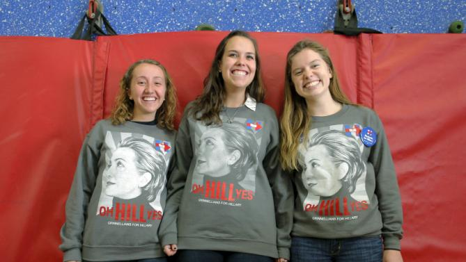 Grinnell College students Sarah McCarthy (L), Mollie Jo Blahunka (C) and Hannah Lundberg pose for a videographer while waiting for U.S. Democratic presidential candidate Hillary Clinton at the Berg Middle School in Newton, Iowa January 28, 2016. REUTERS/Brian Snyder