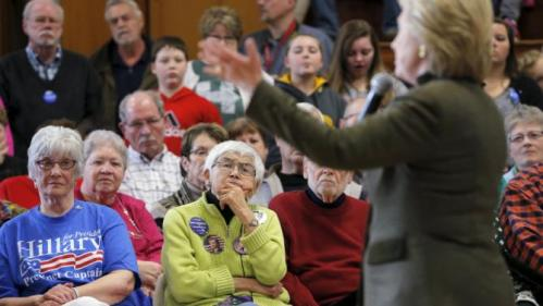 Audience members listen as U.S. Democratic presidential candidate Hillary Clinton speaks during a campaign stop at the Berg Middle School in Newton, Iowa January 28, 2016. REUTERS/Brian Snyder