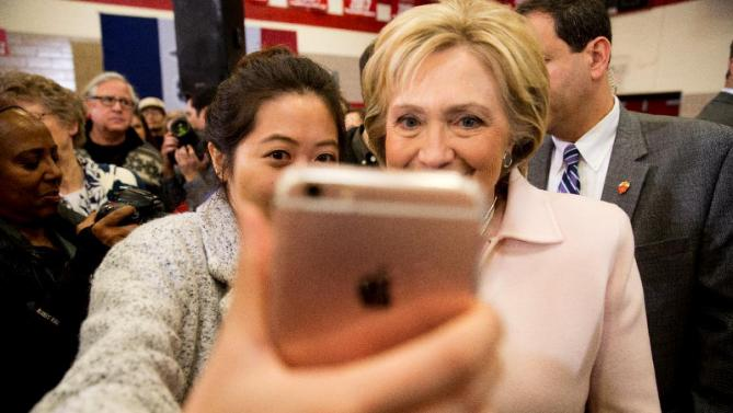 Democratic presidential candidate Hillary Clinton takes a photograph with a member of the audience after speaking at a rally at Grand View University in Des Moines, Iowa, Friday, Jan. 29, 2016. (AP Photo/Andrew Harnik)