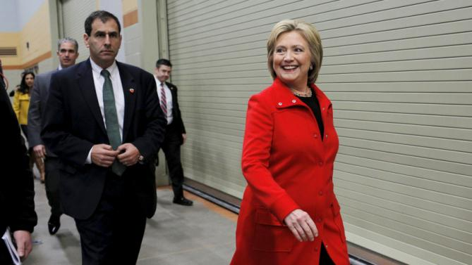 """U.S. Democratic presidential candidate Hillary Clinton arrives for an off-schedule stop at the """"I'll Make Me a World in Iowa Celebration Day"""" in Des Moines, Iowa January 30, 2016. REUTERS/Brian Snyder"""