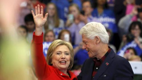 U.S. Democratic presidential candidate Hillary Clinton (L) waves after being introduced onto the stage by husband, former U.S. President Bill Clinton, during a campaign rally at Washington High School in Cedar Rapids, Iowa January 30, 2016. REUTERS/Adrees Latif