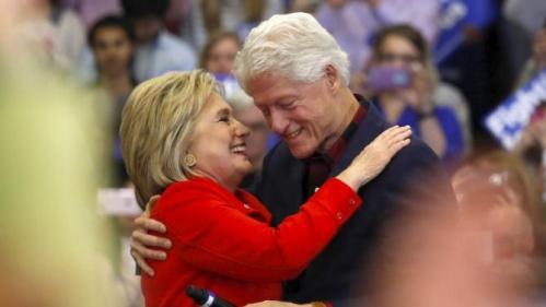 U.S. Democratic presidential candidate Hillary Clinton (L) embraces husband former U.S. President Bill Clinton after being introduced onto the stage during a campaign rally at Washington High School in Cedar Rapids, Iowa January 30, 2016. REUTERS/Adrees Latif