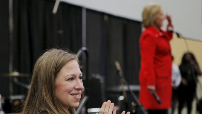 """Chelsea Clinton claps as her mother, U.S. Democratic presidential candidate Hillary Clinton, speaks during an off-schedule stop at the """"I'll Make Me a World in Iowa Celebration Day"""" in Des Moines, Iowa January 30, 2016. REUTERS/Brian Snyder"""