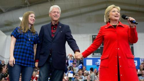 Democratic presidential candidate Hillary Clinton, right, accompanied by former President Bill Clinton and their daughter Chelsea Clinton, arrives to speak at a rally at Washington High School in Cedar Rapids, Iowa, Saturday, Jan. 30, 2016. (AP Photo/Andrew Harnik)