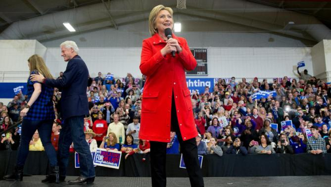 Former President Bill Clinton and his daughter Chelsea Clinton step off the stage as Democratic presidential candidate Hillary Clinton arrives to speak at a rally at Washington High School in Cedar Rapids, Iowa, Saturday, Jan. 30, 2016. (AP Photo/Andrew Harnik)