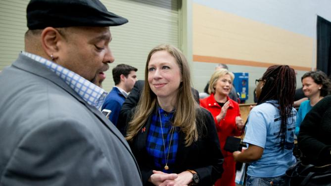 Democratic presidential candidate Hillary Clinton, center right, and her daughter Chelsea Clinton, center, greet visitors to the African American Festival, I'll Make Me a World Celebration Day at the Iowa Events Center in Des Moines, Iowa, Saturday, Jan. 30, 2016. (AP Photo/Andrew Harnik)