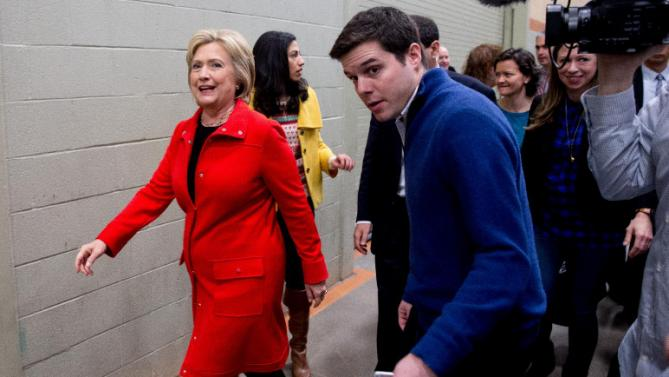 Democratic presidential candidate Hillary Clinton departs after she and her daughter Chelsea Clinton spoke at the African American Festival, I'll Make Me a World Celebration Day at the Iowa Events Center in Des Moines, Iowa, Saturday, Jan. 30, 2016. (AP Photo/Andrew Harnik)