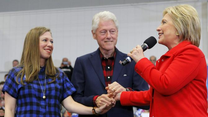 "U.S. Democratic presidential candidate Hillary Clinton is joined by her husband, former U.S. President Bill Clinton, and their daughter Chelsea at a ""Get Out to Caucus"" rally in Cedar Rapids, Iowa January 30, 2016.  REUTERS/Brian Snyder"