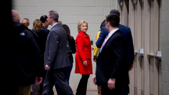 Democratic presidential candidate Hillary Clinton, center, departs after she and her daughter Chelsea Clinton spoke at the African American Festival, I'll Make Me a World Celebration Day at the Iowa Events Center in Des Moines, Iowa, Saturday, Jan. 30, 2016. (AP Photo/Andrew Harnik)