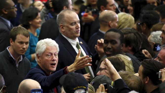 Former U.S. President Bill Clinton greets supporters after a campaign rally led by U.S. Democratic presidential candidate Hillary Clinton at Washington High School in Cedar Rapids, Iowa January 30, 2016.  REUTERS/Adrees Latif
