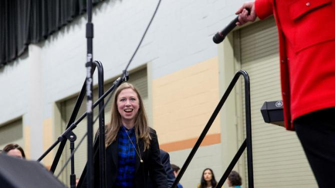 Chelsea Clinton takes the stage along side her mother, Democratic presidential candidate Hillary Clinton, right, at the African American Festival I'll Make Me a World Celebration Day at the Iowa Events Center in Des Moines, Iowa, Saturday, Jan. 30, 2016. (AP Photo/Andrew Harnik)