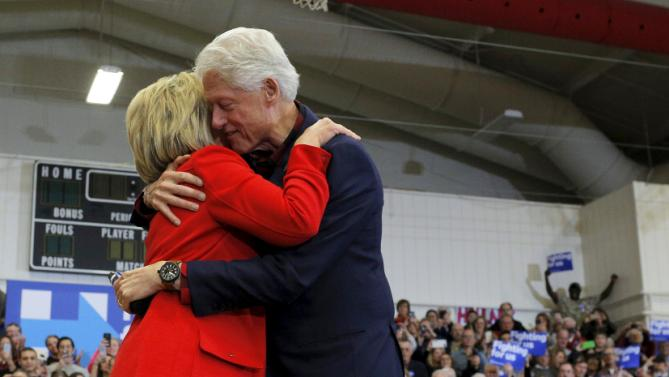 "U.S. Democratic presidential candidate Hillary Clinton and former U.S. President Bill Clinton hug after he introduced her at a ""Get Out to Caucus"" rally in Cedar Rapids, Iowa January 30, 2016.  REUTERS/Brian Snyder"