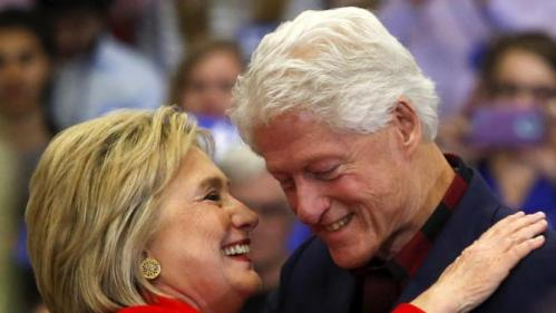 U.S. Democratic presidential candidate Hillary Clinton (L) embraces husband former U.S. President Bill Clinton after he introduced her onto the stage during a campaign rally at Washington High School in Cedar Rapids, Iowa January 30, 2016. REUTERS/Adrees Latif