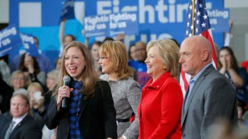 "Chelsea Clinton speaks as her mother U.S. Democratic presidential candidate Hillary Clinton stands with Gabby Giffords and her husband Mark Kelly (R) during a ""Get Out to Caucus"" rally at Iowa State University in Ames, Iowa January 30, 2016. The New York Times's editorial board endorsed Democrat Hillary Clinton and Republican John Kasich as they seek to become their parties' nominees in the U.S. presidential election, calling Clinton one of the most ""deeply qualified presidential candidates in modern history."" REUTERS/Brian Snyder"