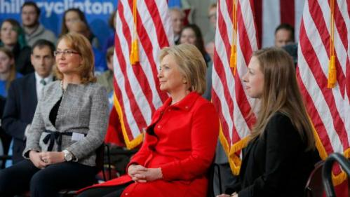 "Chelsea Clinton sits with her mother U.S. Democratic presidential candidate Hillary Clinton and Gabby Giffords during a ""Get Out to Caucus"" rally at Iowa State University in Ames, Iowa January 30, 2016. The New York Times's editorial board endorsed Democrat Hillary Clinton and Republican John Kasich as they seek to become their parties' nominees in the U.S. presidential election, calling Clinton one of the most ""deeply qualified presidential candidates in modern history."" REUTERS/Brian Snyder"