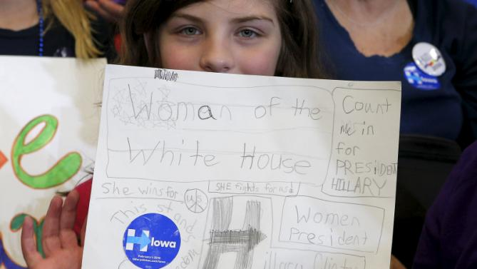 "Six year-old Aubrianna Cox holds a handwritten sign for U.S. Democratic presidential candidate Hillary Clinton at a ""Get Out to Caucus"" rally in Cedar Rapids, Iowa January 30, 2016.  REUTERS/Brian Snyder"