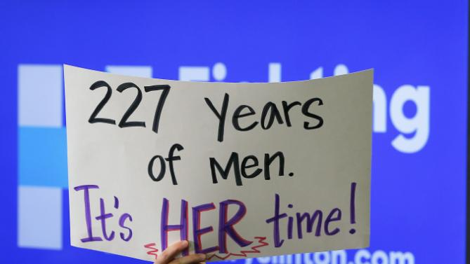 "An sudden remember holds a sign reading ""227 Years of Men.  Its Her Time!"" during a ""Get Out to Caucus"" rally with U.S. Democratic presidential candidate Hillary Clinton in Cedar Rapids, Iowa January 30, 2016.  REUTERS/Brian Snyder"