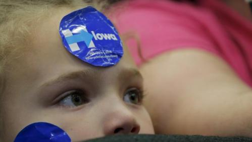 "Seven-year-old Alexis Griffiths listens as U.S. Democratic presidential candidate Hillary Clinton speaks during a ""Get Out to Caucus"" rally in Cedar Rapids, Iowa January 30, 2016. REUTERS/Brian Snyder"