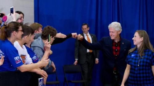 Former President Bill Clinton gives a member of the audience a fist bump as he and his daughter Chelsea Clinton, arrive to speak at a rally for Democratic presidential candidate Hillary Clinton at Washington High School in Cedar Rapids, Iowa, Saturday, Jan. 30, 2016. (AP Photo/Andrew Harnik)