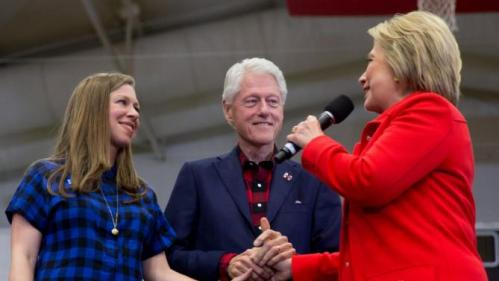 Democratic presidential candidate Hillary Clinton, right, accompanied by former President Bill Clinton and their daughter Chelsea Clinton, speaks at a rally at Washington High School in Cedar Rapids, Iowa, Saturday, Jan. 30, 2016. (AP Photo/Andrew Harnik)