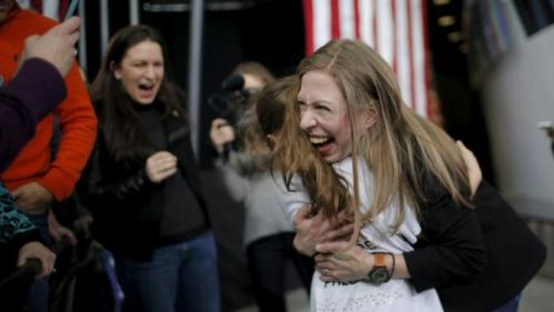 Chelsea Clinton gets a hug from six-year-old Lily Salazar at a campaign rally with U.S. Democratic presidential candidate Hillary Clinton at Iowa State University in Ames, Iowa January 30, 2016. REUTERS/Brian Snyder
