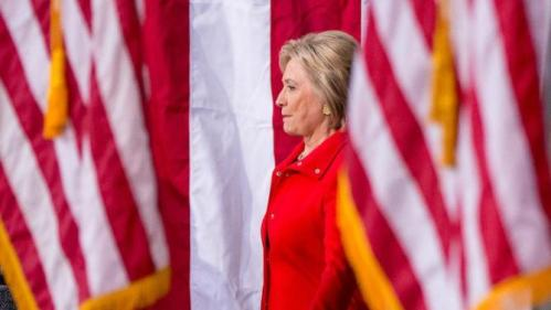 Democratic presidential candidate Hillary Clinton, center, arrives for a rally at Iowa State University in Ames, Iowa Saturday, Jan. 30, 2016. (AP Photo/Andrew Harnik)