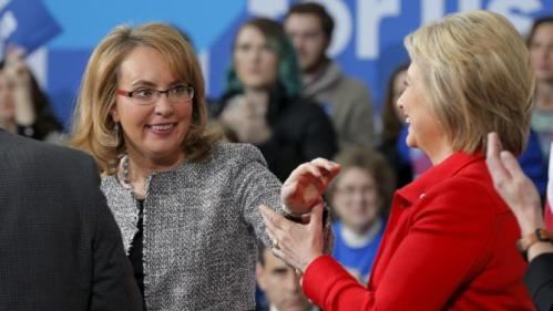 "Former U.S. Congresswoman Gabby Giffords (L) introduces U.S. Democratic presidential candidate Hillary Clinton during a ""Get Out to Caucus"" rally at Iowa State University in Ames, Iowa January 30, 2016. REUTERS/Brian Snyder"