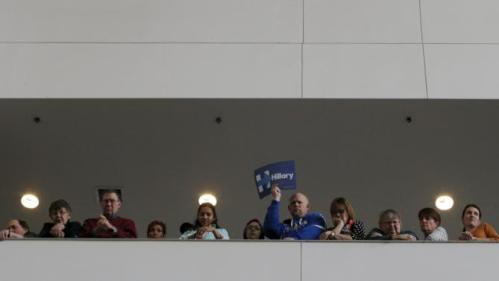 """Audience members listen as U.S. Democratic presidential candidate Hillary Clinton speaks during a """"Get Out to Caucus"""" rally at Iowa State University in Ames, Iowa January 30, 2016. REUTERS/Brian Snyder"""