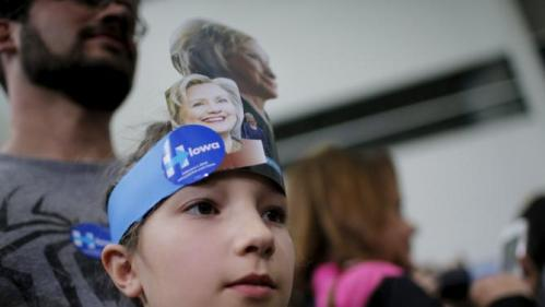 """Ten year-old Celia Schrag watches U.S. Democratic presidential candidate Hillary Clinton greet audience members during a """"Get Out to Caucus"""" rally at Iowa State University in Ames, Iowa January 30, 2016. REUTERS/Brian Snyder"""