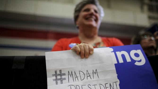 "A woman holds a handwritten sign that reads ""Madam President"" during a ""Get Out to Caucus"" rally with U.S. Democratic presidential candidate Hillary Clinton in Cedar Rapids, Iowa January 30, 2016.  REUTERS/Brian Snyder"