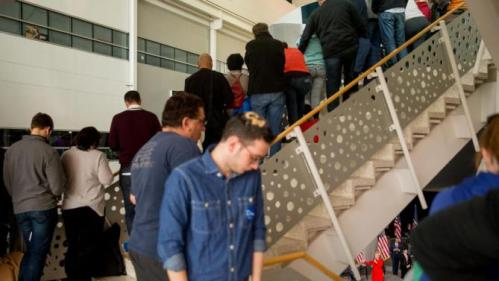 Visitors line the staircase as Democratic presidential candidate Hillary Clinton, bottom right, speaks at a rally at Iowa State University in Ames, Iowa Saturday, Jan. 30, 2016. (AP Photo/Andrew Harnik)