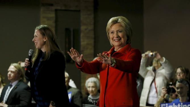 REFILE - CORRECTING DATEU.S. Democratic presidential candidate Hillary Clinton and her daughter Chelsea speak at a campaign event in Carroll, Iowa January 30, 2016. REUTERS/Jim Bourg