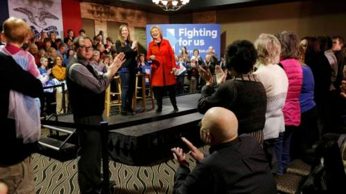 Democratic U.S. presidential candidate Hillary Clinton gets a standing ovation at the conclusion of her campaign event in Carroll, Iowa, January 30, 2016. REUTERS/Jim Bourg
