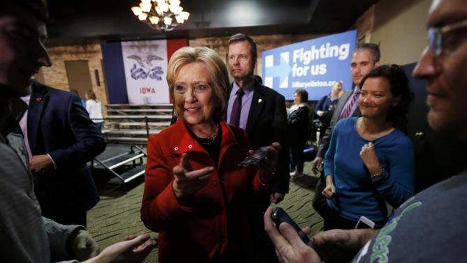 U.S. Democratic presidential candidate Hillary Clinton talks with Iowa supporters at the end of her campaign event in Carroll, Iowa January 30, 2016. REUTERS/Jim Bourg