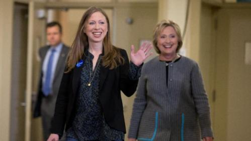 Democratic presidential candidate Hillary Clinton, accompanied by her daughter Chelsea Clinton, arrives for a rally at Abraham Lincoln High School in Council Bluffs, Iowa, Sunday, Jan. 31, 2016. (AP Photo/Andrew Harnik)