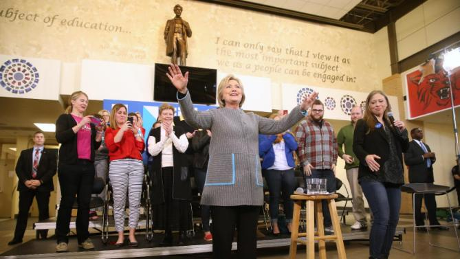 Democratic presidential candidate Hillary Clinton, accompanied by her daughter Chelsea Clinton, speaks at a rally at Abraham Lincoln High School in Council Bluffs, Iowa, Sunday, Jan. 31, 2016. (AP Photo/Andrew Harnik)