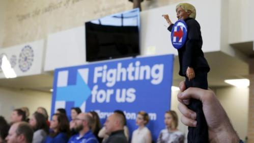 "An audience member holds up a doll of U.S. Democratic presidential candidate Hillary Clinton during a ""Get Out to Caucus"" rally in Council Bluffs, Iowa January 31, 2016, one day before Iowa's first-in-the-nation caucus. REUTERS/Brian Snyder"